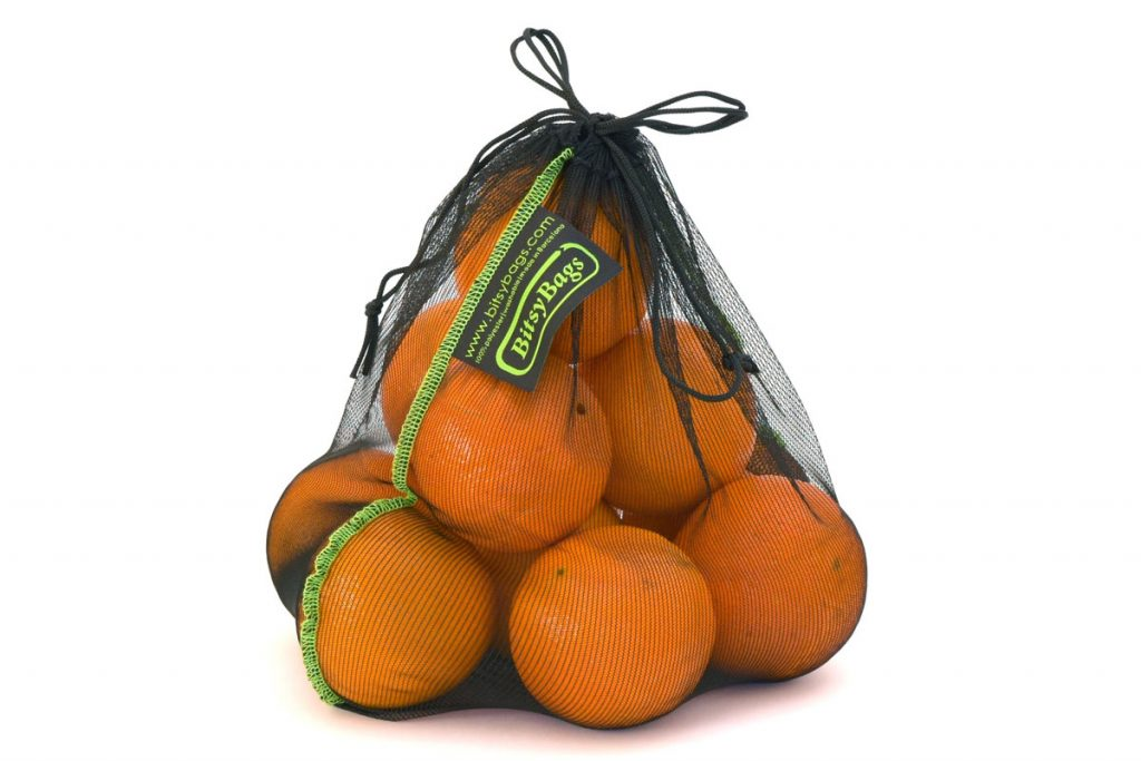 Oranges in a reusable net produce bag