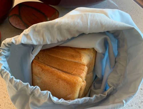 Sliced bread in cloth bag