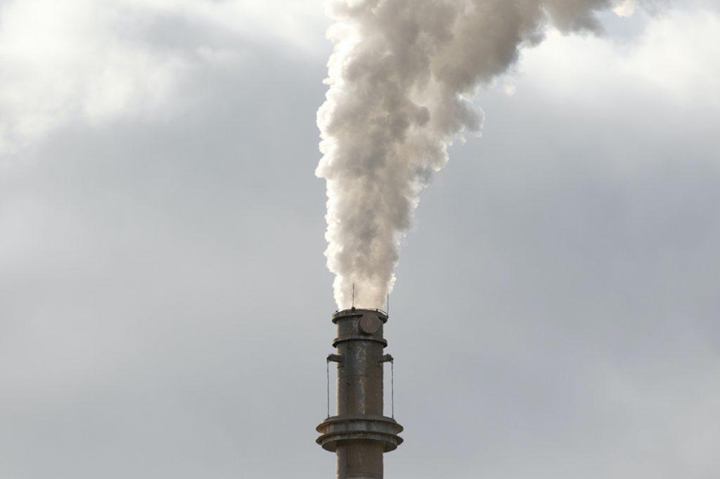 smoke spewing out of smoke stack