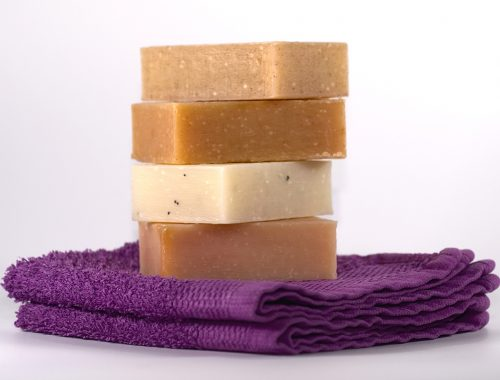 Stack of natural soap on washcloths