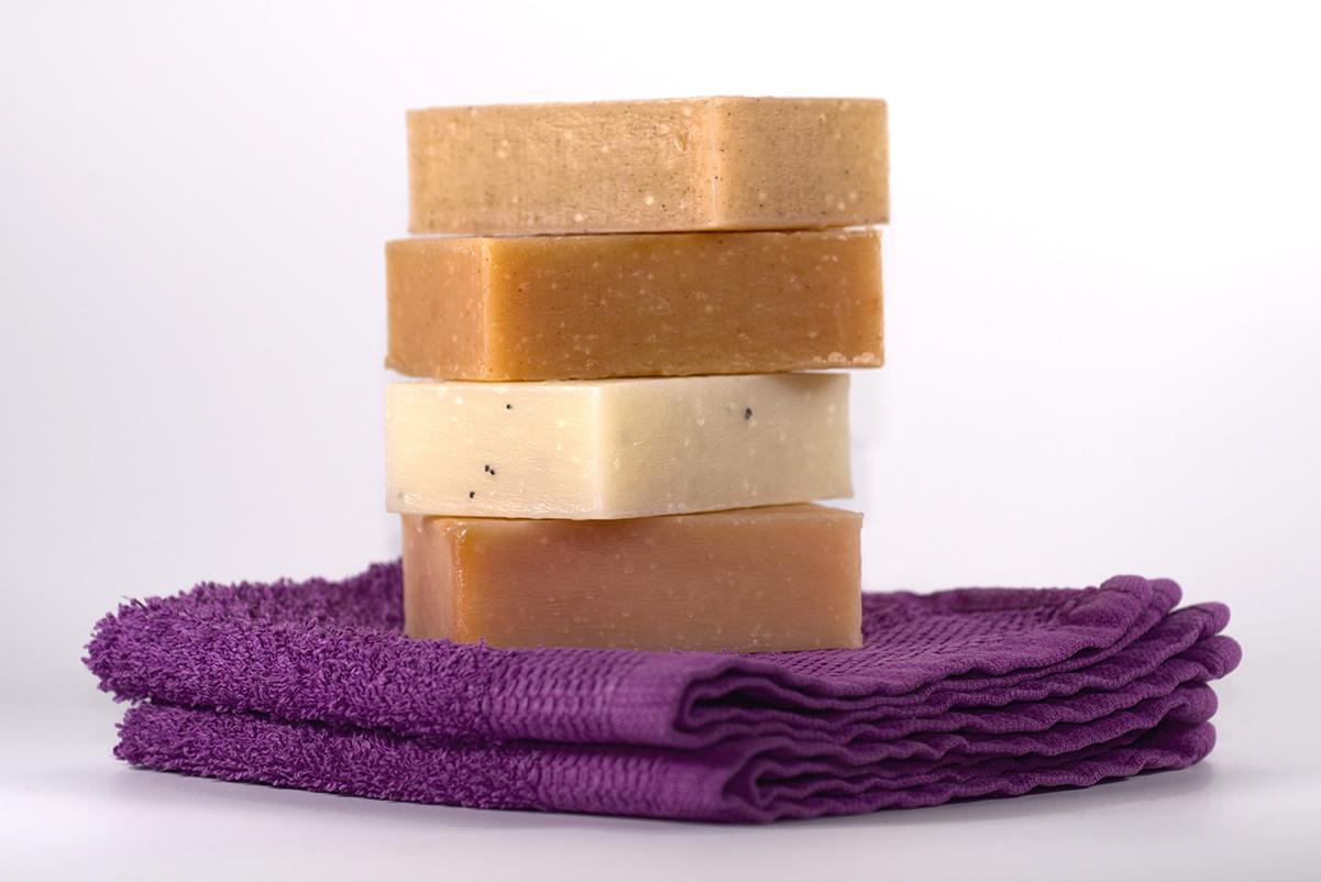 Stack of natural soap on washcloths