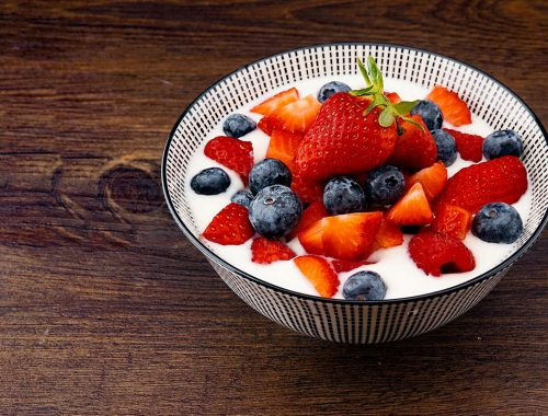 Homemade Yoghurt in bowl with berries