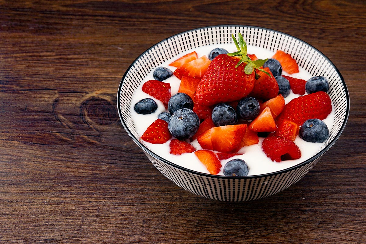 Homemade Yoghurt in bowl with berries