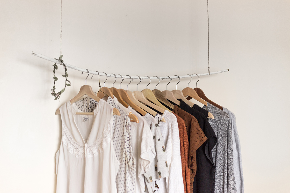 Sustainable clothes on rustic rack