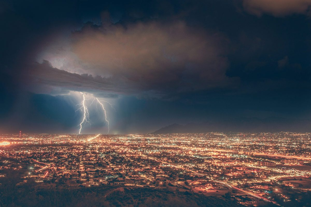 storm over a brightly lit city